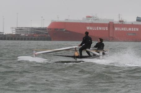 kite sailing high speed red ship